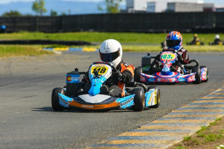 Image of 2 go carts with riders